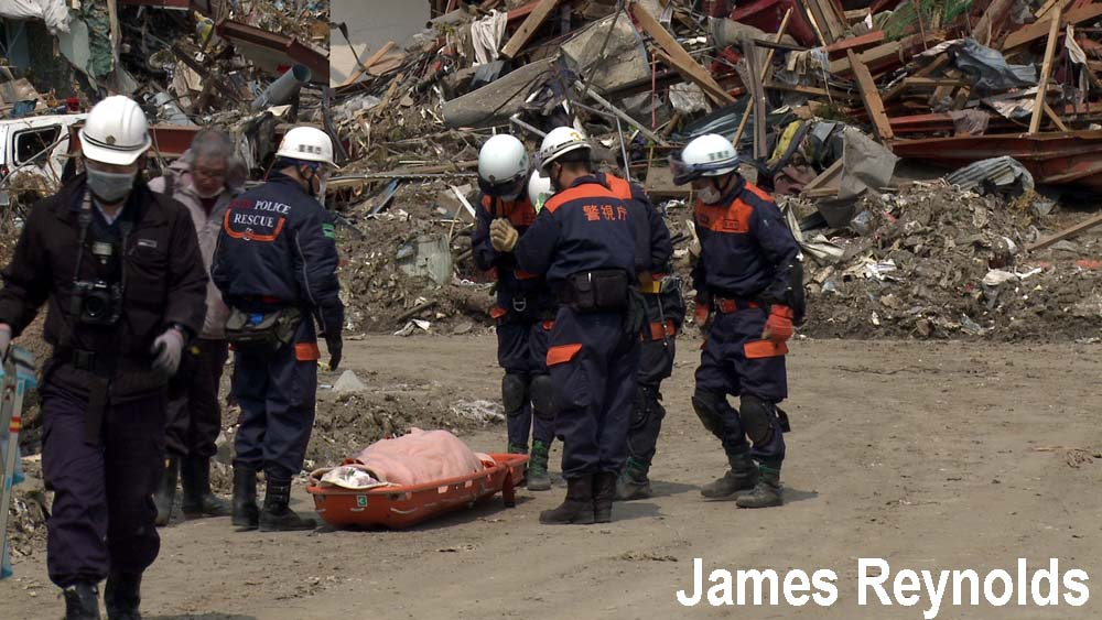 Rescue services retrieve a body three weeks after the tsunami in Rikuzentakata